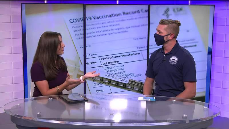Jason Elliott, spokesperson for the Blue Ridge Health District, talks with Elizabeth Holmes...